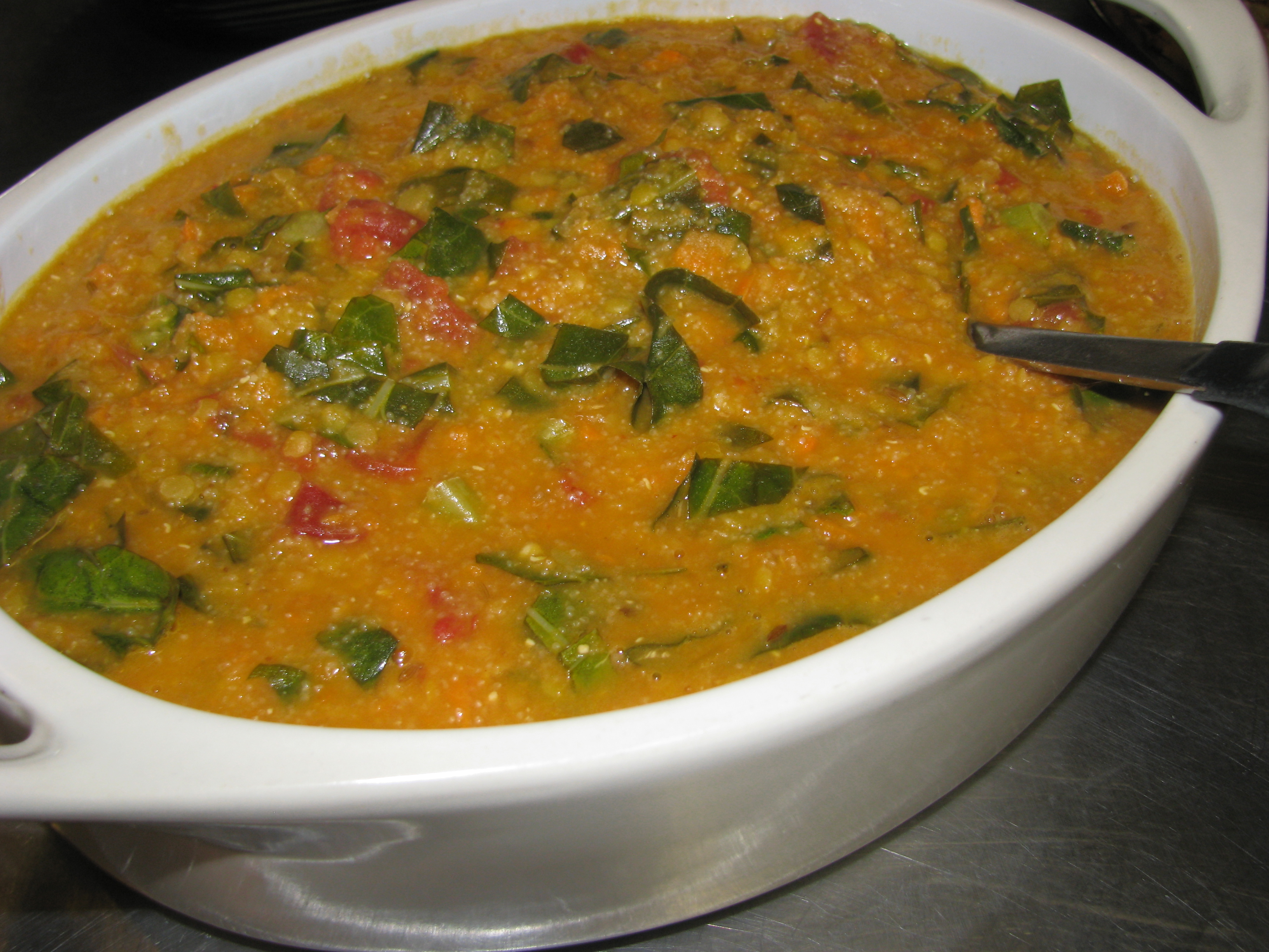 AFRICAN-SPICED COCONUT TEFF & RED LENTIL STEW WITH COLLARDS & YAMS