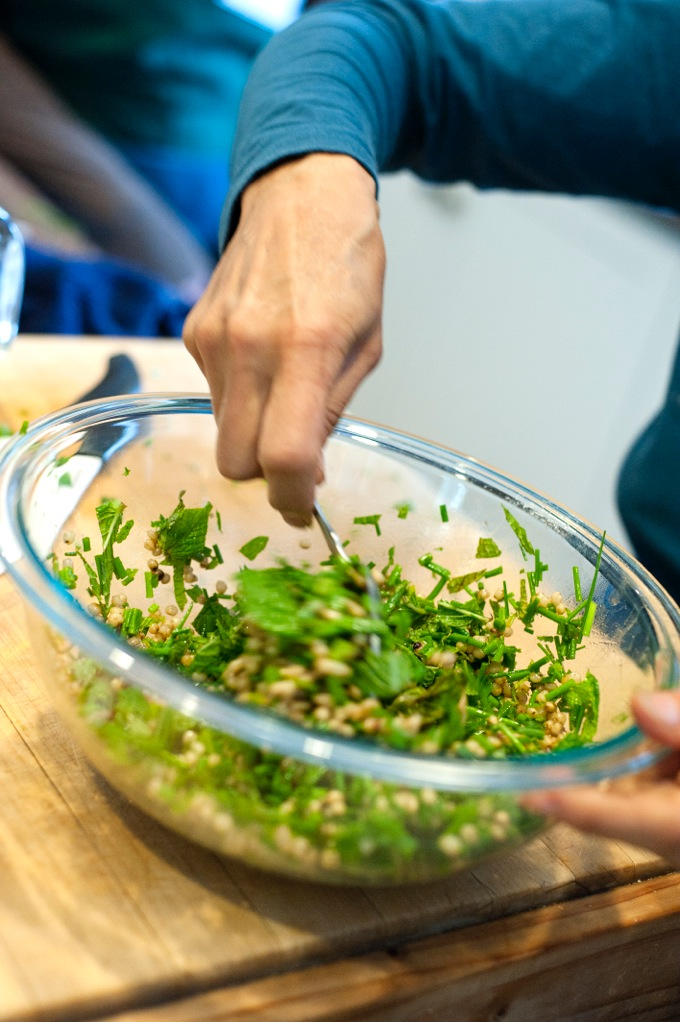 At Esalen, Leslie Stirs chopped fresh herbs into a salad