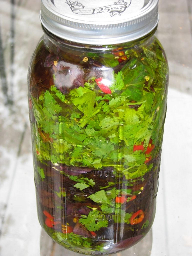 organic herbs and spices make a delicious flavored oil