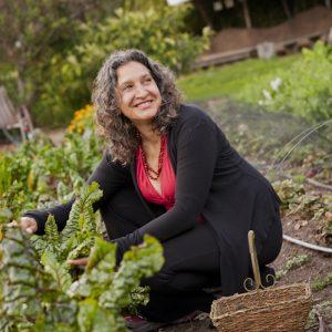 Leslie Cerier picking fresh vegetables for hands on cooking classes