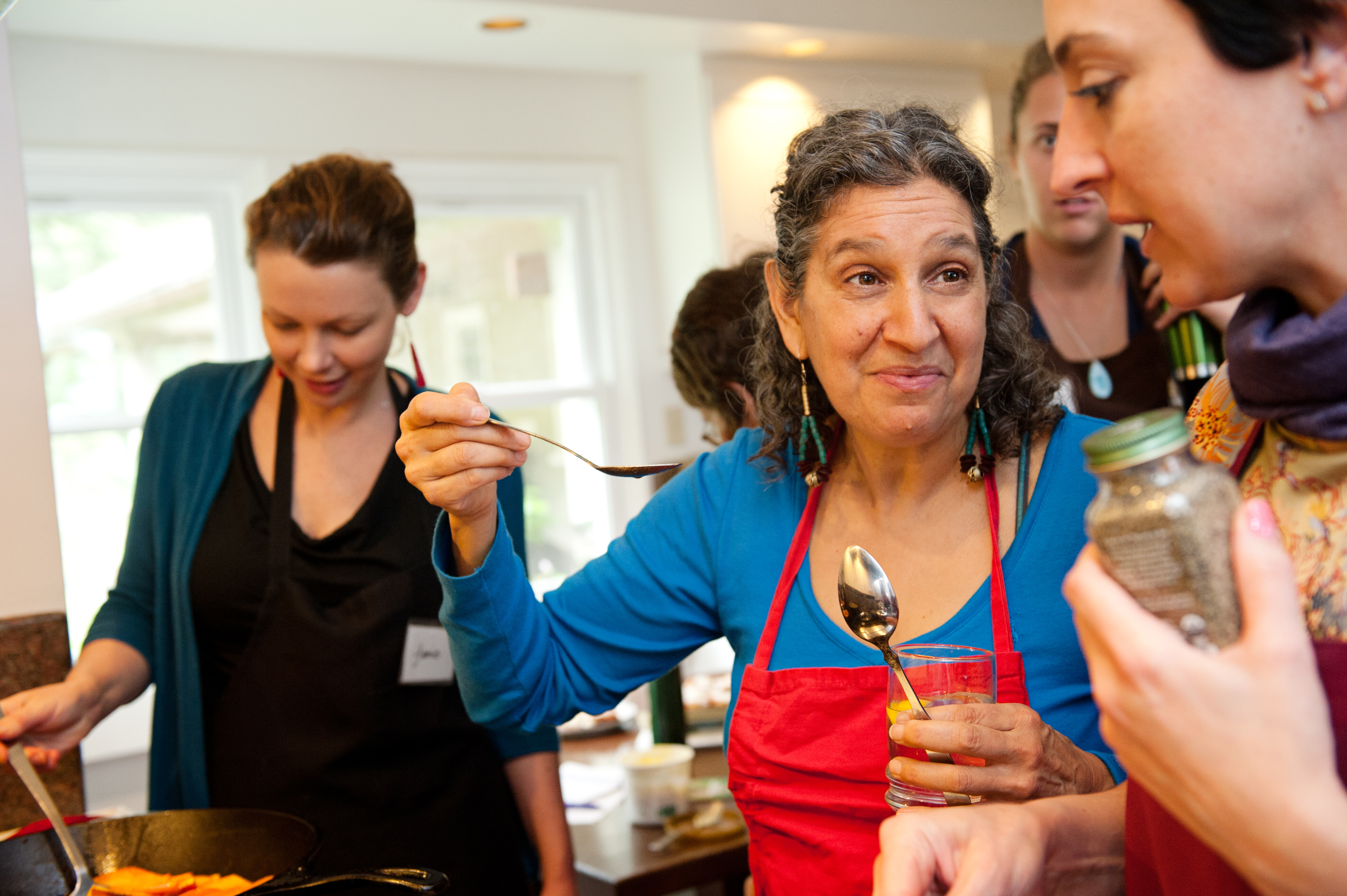 Teaching cooking, Leslie Cerier instructs to taste the recipe