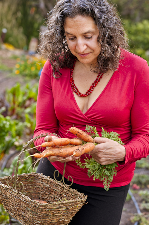 Leslie Cerier, The Organic Gourmet picking carrots in the organic Esalen Institute garden