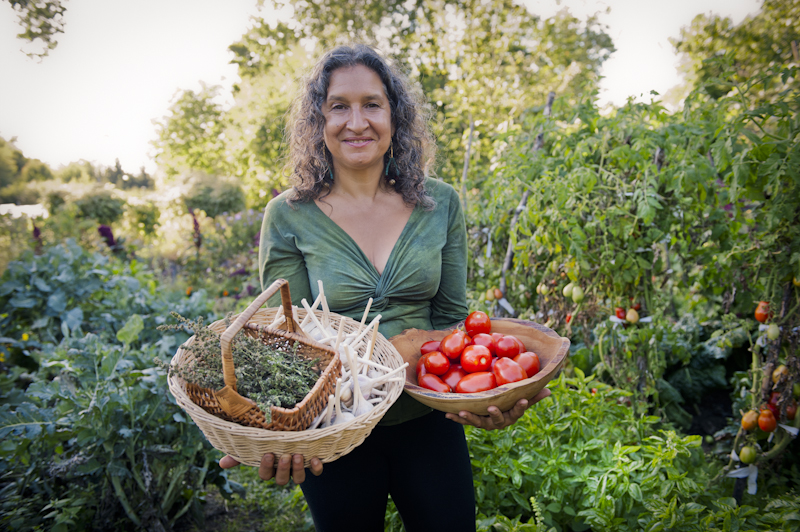 Leslie in Appollo's Organic Gardenholding tomatoes