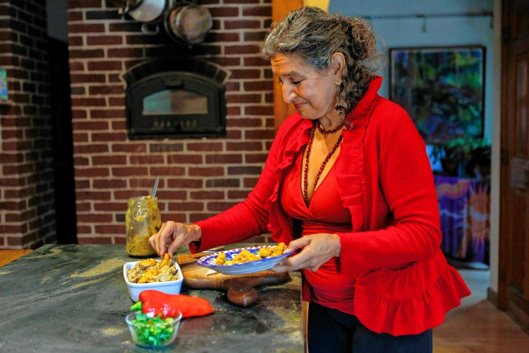 Leslie Cerier plates a tempeh stew dish Oct. 27 in her Shutesbury home.
