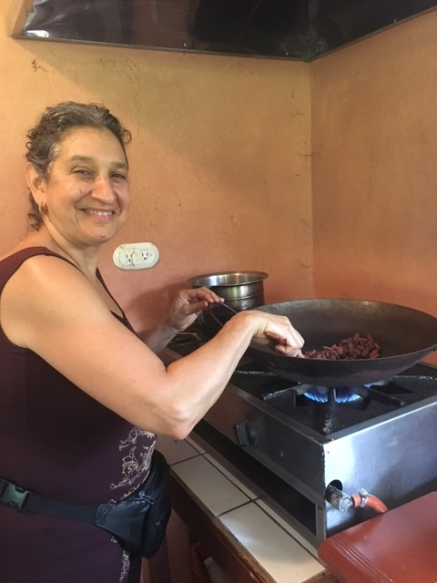 Leslie Cerier Roasting organic cocoa beans in Costa Rica