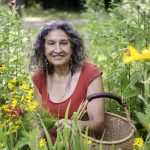 Joyful, Leslie Cerier, The Organic Gourmet in her organic flower garden offers Luscious Organic Lifestyle Retreats
